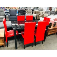7 PIECE DINING SUITE - BLACK GLASS TOP TABLE 6 RED CHAIRS (FACTORY SECOND - SOME DAMAGE)