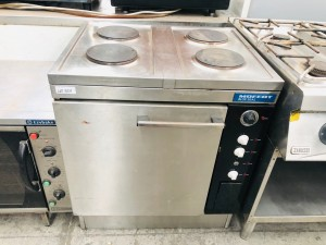COMMERCIAL OVEN AND FOUR (4) BURNER STOVE - USED - SOLD AS IS
