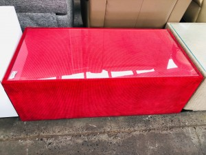 LARGE RED GLASS TOP COFFEE TABLE