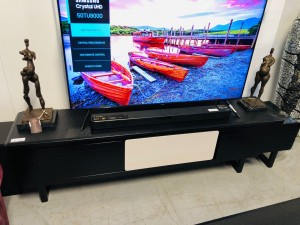 BLACK AND CREAM ENTERTAINMENT UNIT WITH BLACK ROCK TOP