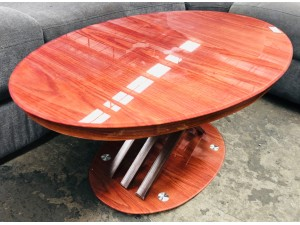 SMALL BROWN OVAL COFFEE TABLE